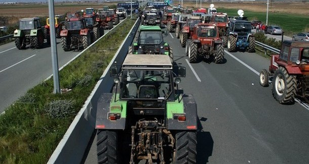 Protesting farmers use tractors to block